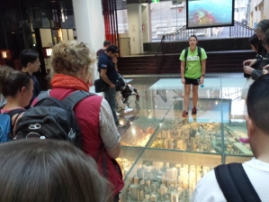 Our tour guide showing us a scale model of the city in the library
