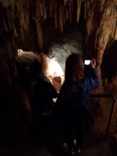 Jenolan Caves: Steph taking pictures while going down steep stairs